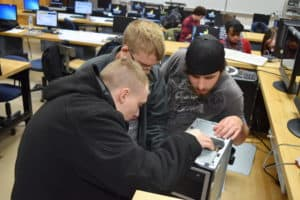 Students reassembling a computer as part of a club competition