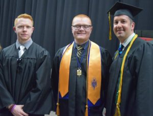 Students at graduation with honors cords