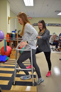 Physical Therapy Students Working on Exercises