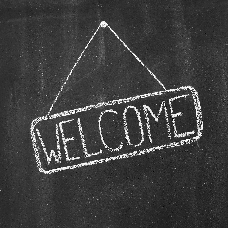 Welcome written on a black chalkboard