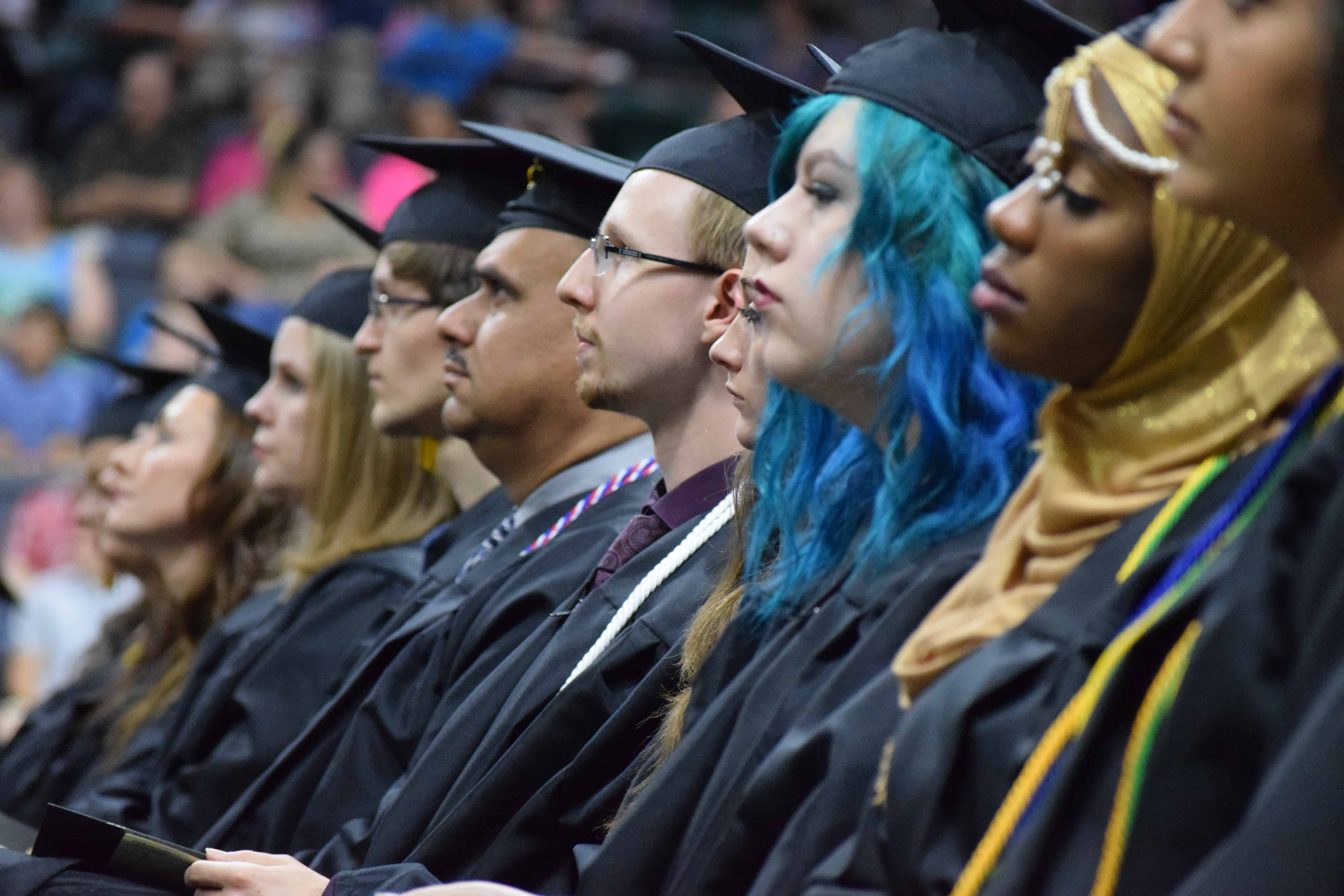 Grads sitting in row at QC Commencement 2017