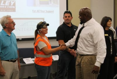 Highway construction graduates shaking hands