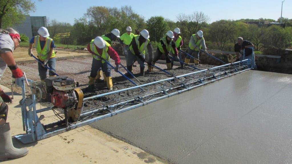Highway Construction Program pouring concrete