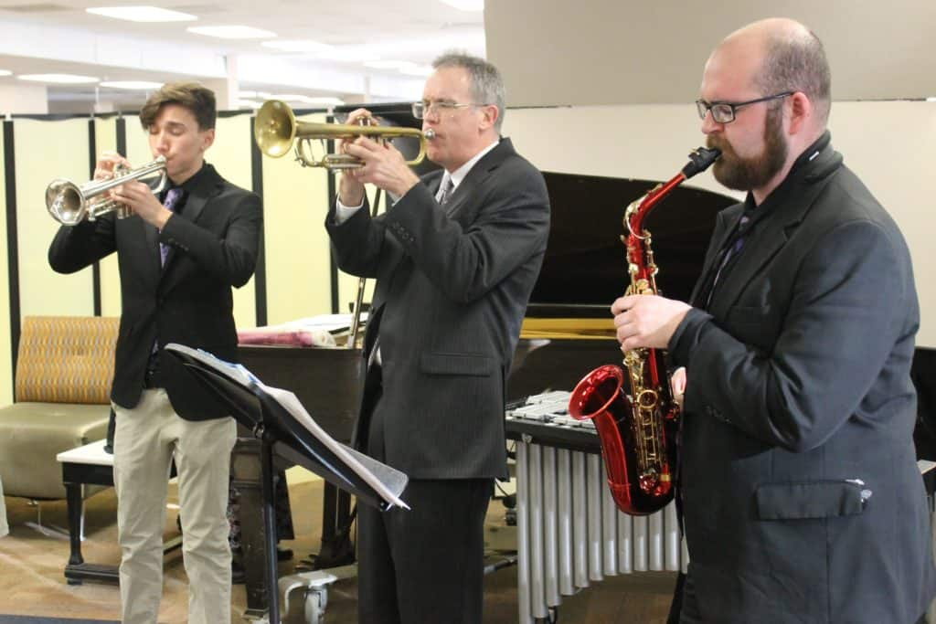 3 members of BHC Jazz Band playing trumpets and alto sax