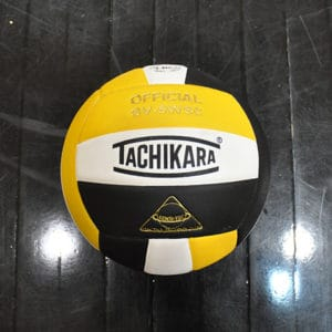 Black and gold volleyball close-up photo