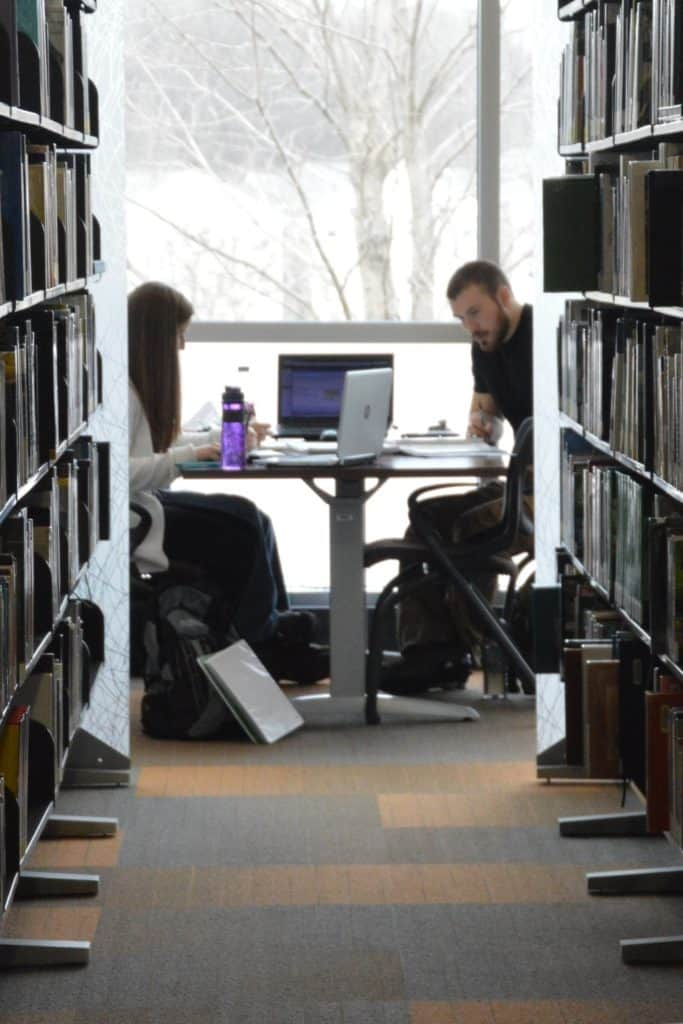 two students studying at table in QC Library 3-9-16 (vertical)