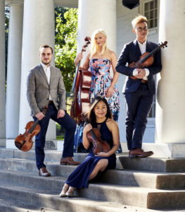 4 musicians on steps with their string instruments