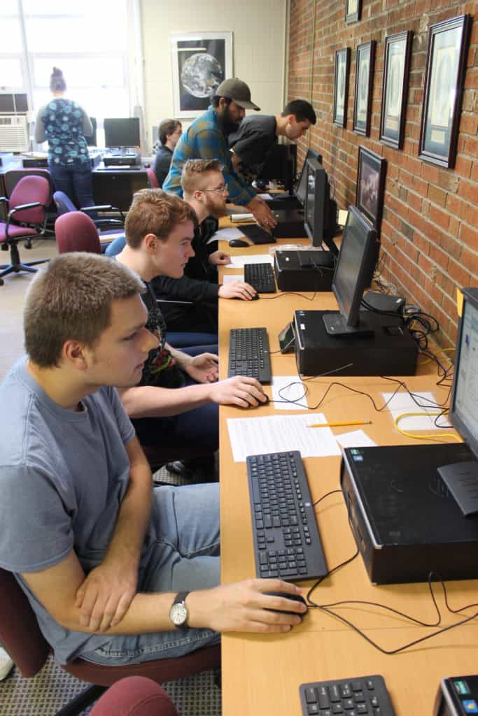 IT students working on computers
