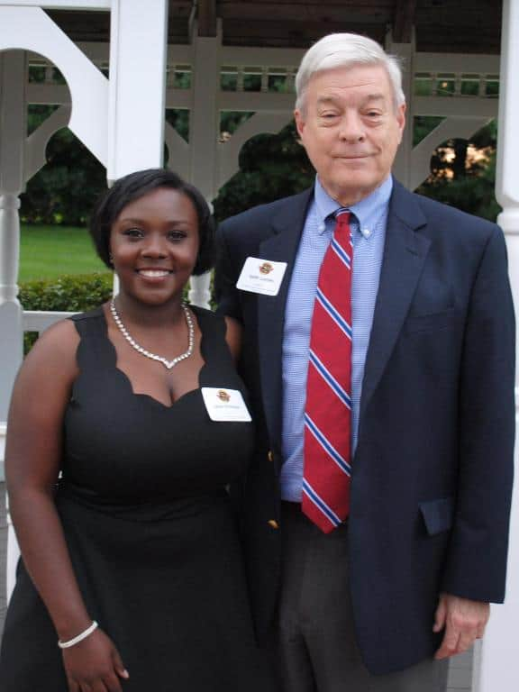 female student & male scholarship donor smiling at camera