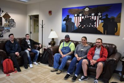 Black Hawk College student veterans sitting on couches in the Veterans Resource Center