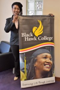 BHC graduate Tamica Reynolds holding large BHC sign