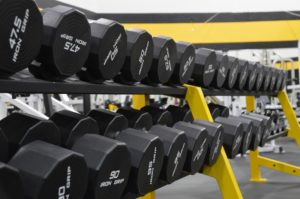 black weights lined up in the Fitness Center