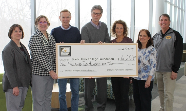 7 people holding oversized check