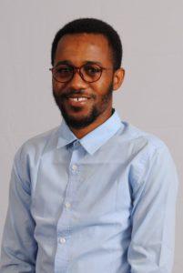 Amadou Abasse Ndiaye wearing glasses and blue shirt