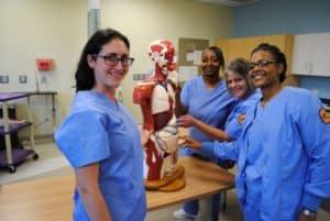 nursing students standing around take of equipment