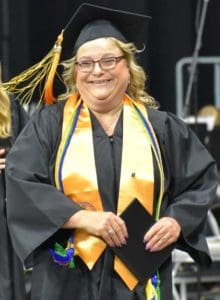 BHC graduate Kristie Amato in her graduation gown, holding her diploma