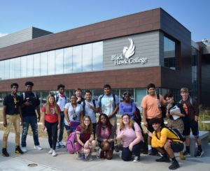 students pose in front of the Building 1 addition