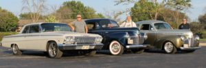 3 men with vintage automobiles