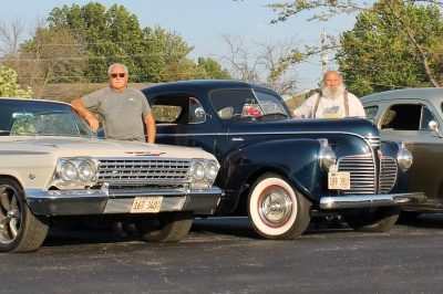 3 men with vintage automobiles