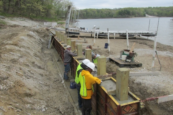 people building retaining wall at Lake George