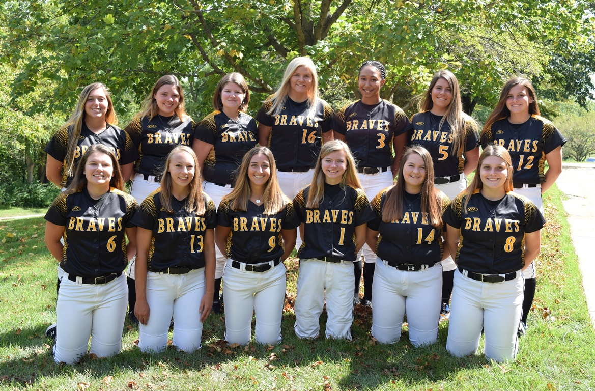 Softball team in Black Hawk College Braves uniforms