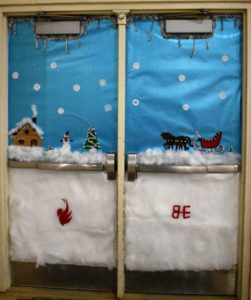 double doors decorated with snowy scene