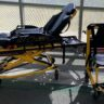 RI Fire Dept donates power cot, stair chair to EMS program