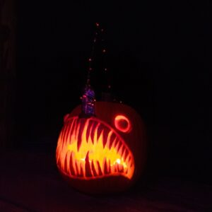 pumpkin carved to look like toothy fish