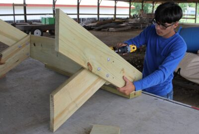 man works on a carpentry project