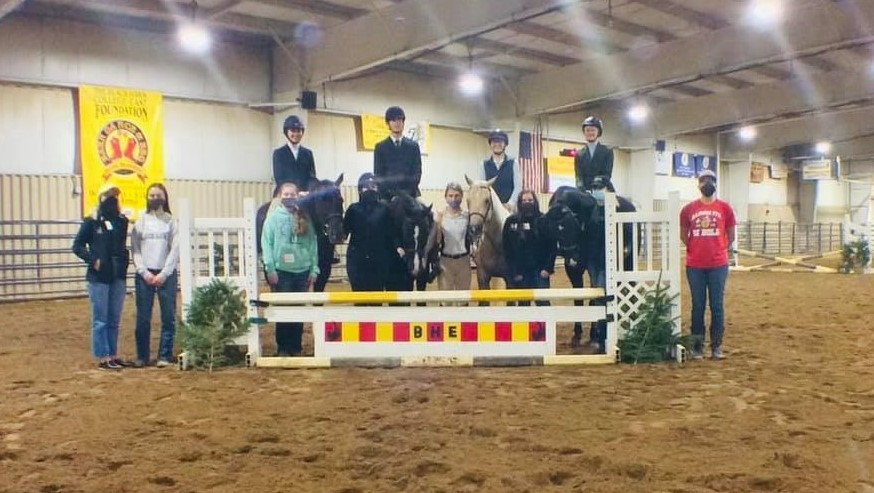 hunt seat (English) riders and horses in arena