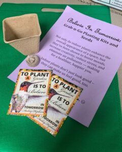 2 seed packets & small fiberboard planter on piece of paper