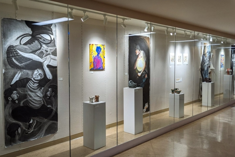 gallery with artwork behind glass