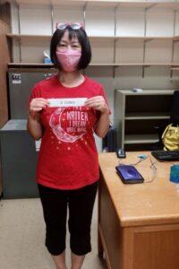 Xixuan Collins wearing mask & standing in her empty office