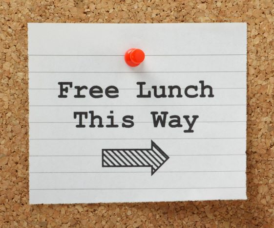 Free lunch this way note tacked on cork board