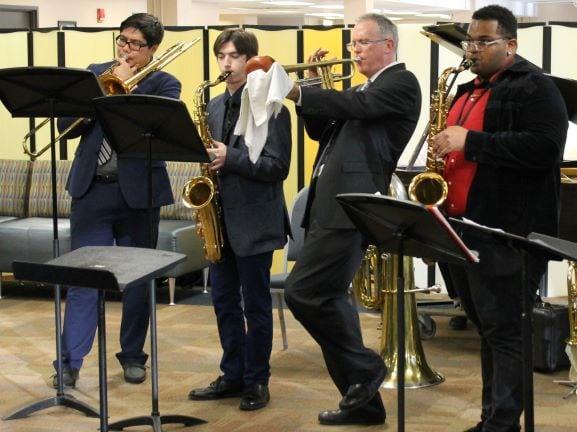 4 jazz musicians playing trombone, sax & trumpet